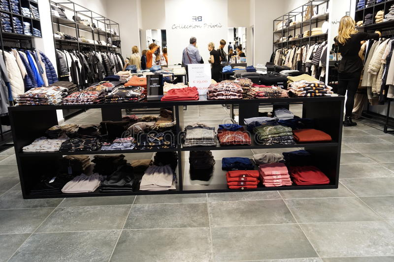Interior of shop of clothes stock photography