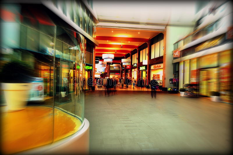 Interior of shopping center with blur of motion stock photo