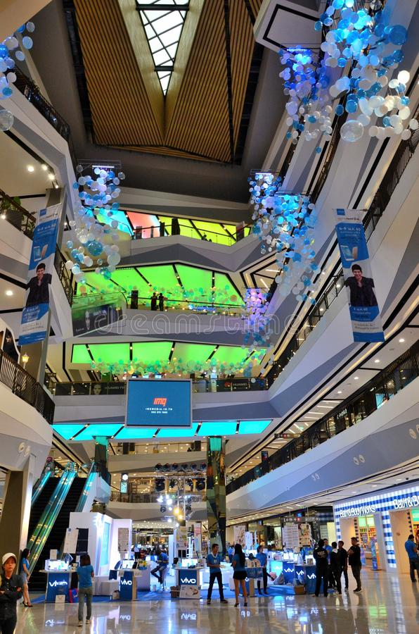 Interior of shopping mall atrium with mobile phone sales set up Hatyai Thailand. Hatyai, Thailand - May 9, 2017: The interior of a shopping mall decked with blue royalty free stock photography