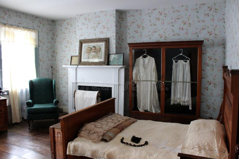 Interior shot of bedroom of shop owners who once dealt with buyers on the Erie Canal, Old Palmyra, New York, 2018. Interior shot of bedroom inside upper level of royalty free stock photo