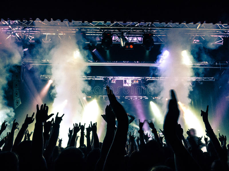 Concert crowd in front of stage lights royalty free stock photo