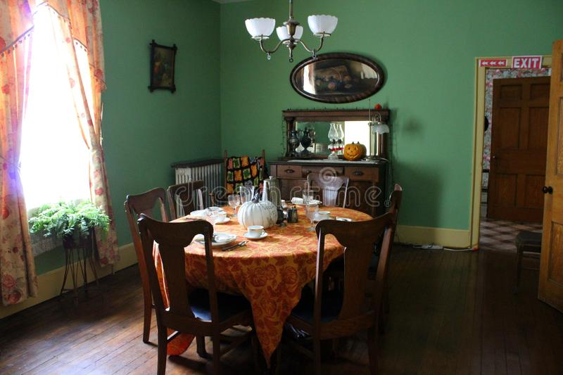 Interior shot of dining area in shop owners home who once dealt with buyers on the Erie Canal, Old Palmyra, New York, 2018. Interior shot of dining room set for stock image