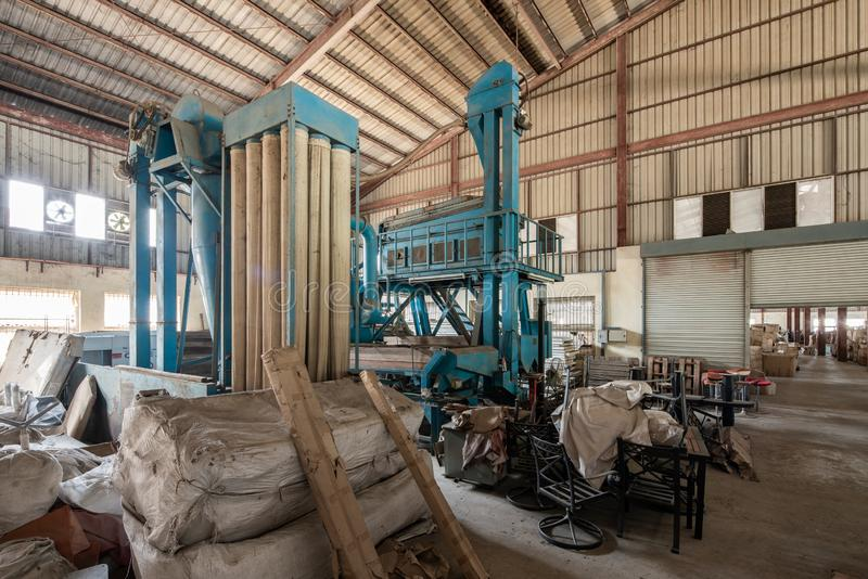 Interior shot of an empty old factory filled with wood and boxes royalty free stock photo