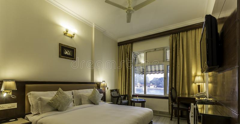 Interior shot of a hotel room on the banks of river Ganga. Seen flowing through the window royalty free stock photography