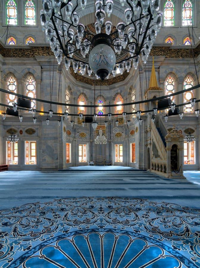 Interior shot of Nuruosmaniye Mosque overlooking niche Mihrab and marble minbar Platform facade, Istanbul, Turkey. Interior shot of Nuruosmaniye Mosque, an stock photo