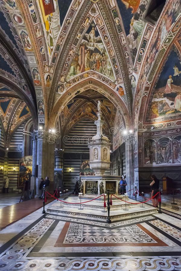 Interior of the Siena Baptistery, Italy royalty free stock images