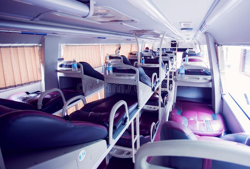Interior of sleeper bus for tourists and other passengers stock image