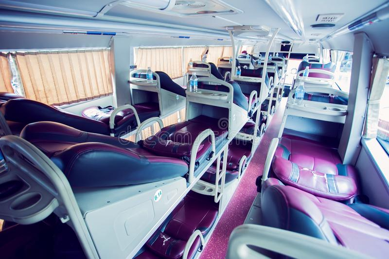Interior of sleeper bus for tourists and other passengers stock photo