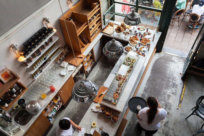 Interior of a small cafe with breakfasts in loft-style. The bar counter. View from above stock photos