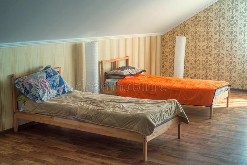 Interior of small hostel room with two beds stock photography