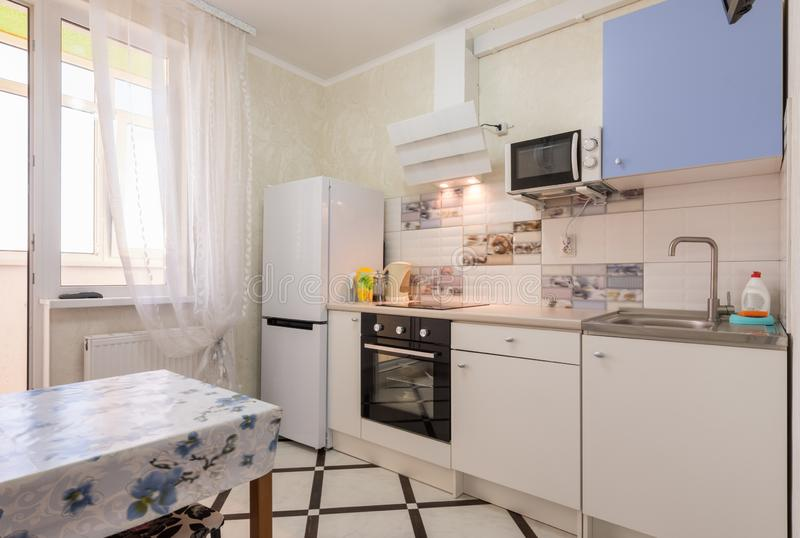 The interior of a small kitchen in the apartment stock images
