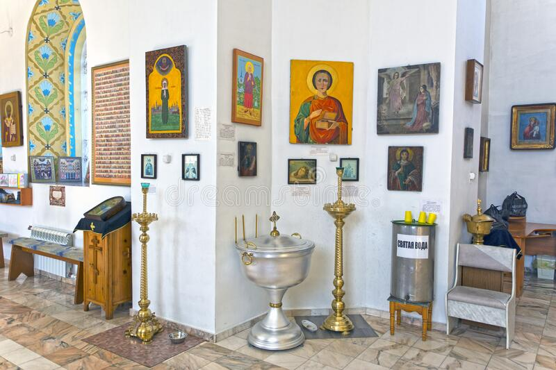 The interior of a small provincial church, the interior decoration. Icons, prayers. Russia royalty free stock photography