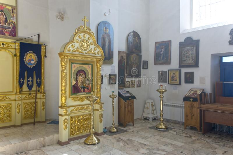 The interior of a small provincial church, the interior decoration. Icons, prayers. Russia royalty free stock photo