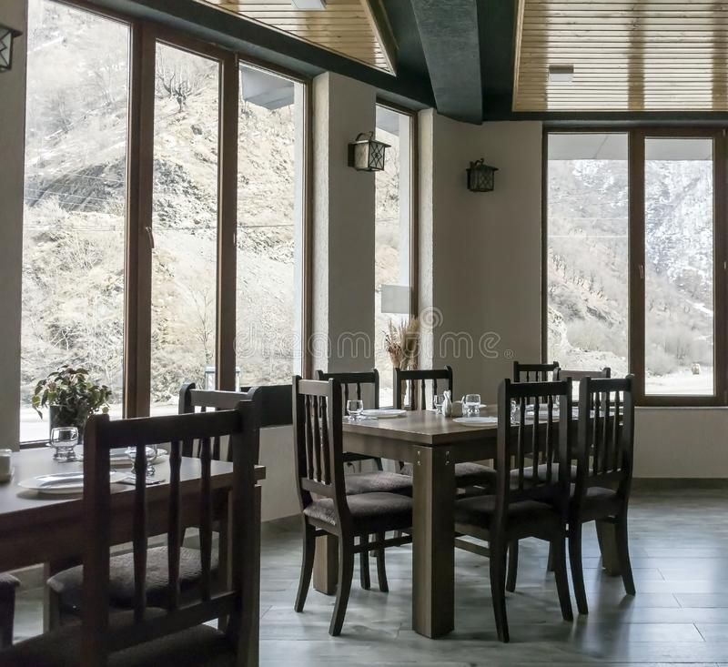 Interior of a small roadside Georgian cafe with large panoramic Windows. Overlooking the mountains stock photo