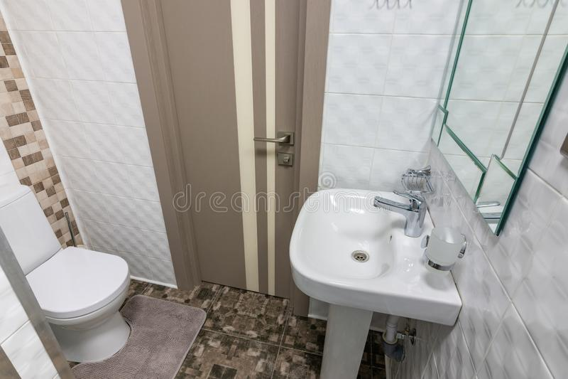 The interior of a small toilet in the hotel room stock images