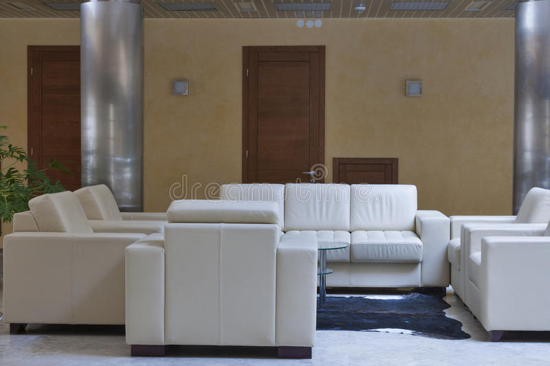 Interior with sofas and armchairs stock photos