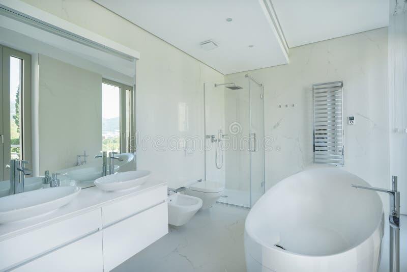 Interior of a spacious bathroom in a luxury villa royalty free stock photos
