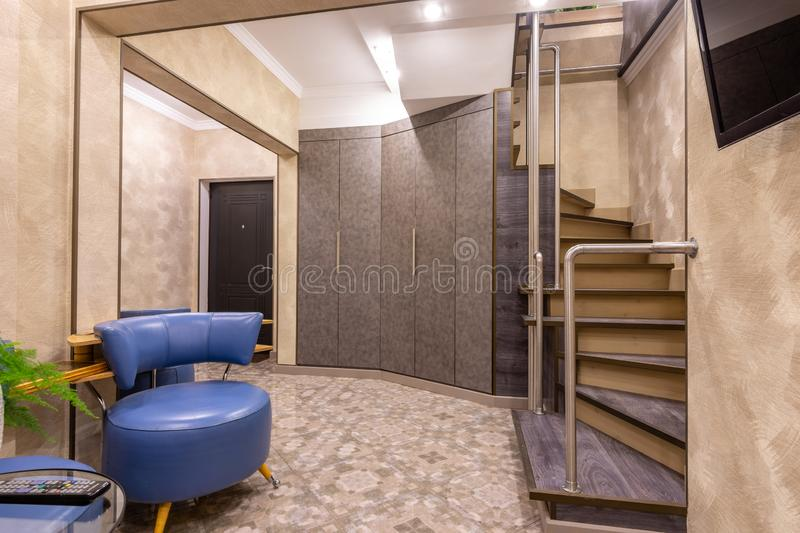 The interior is a spacious hallway, with a staircase to the second floor royalty free stock photo