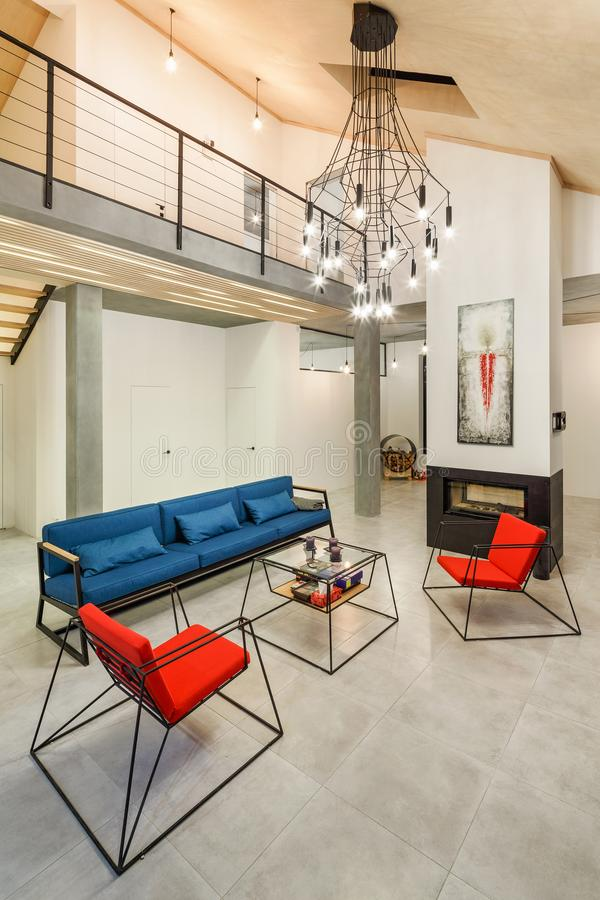 The interior of the spacious living room is modern in style with stock photo