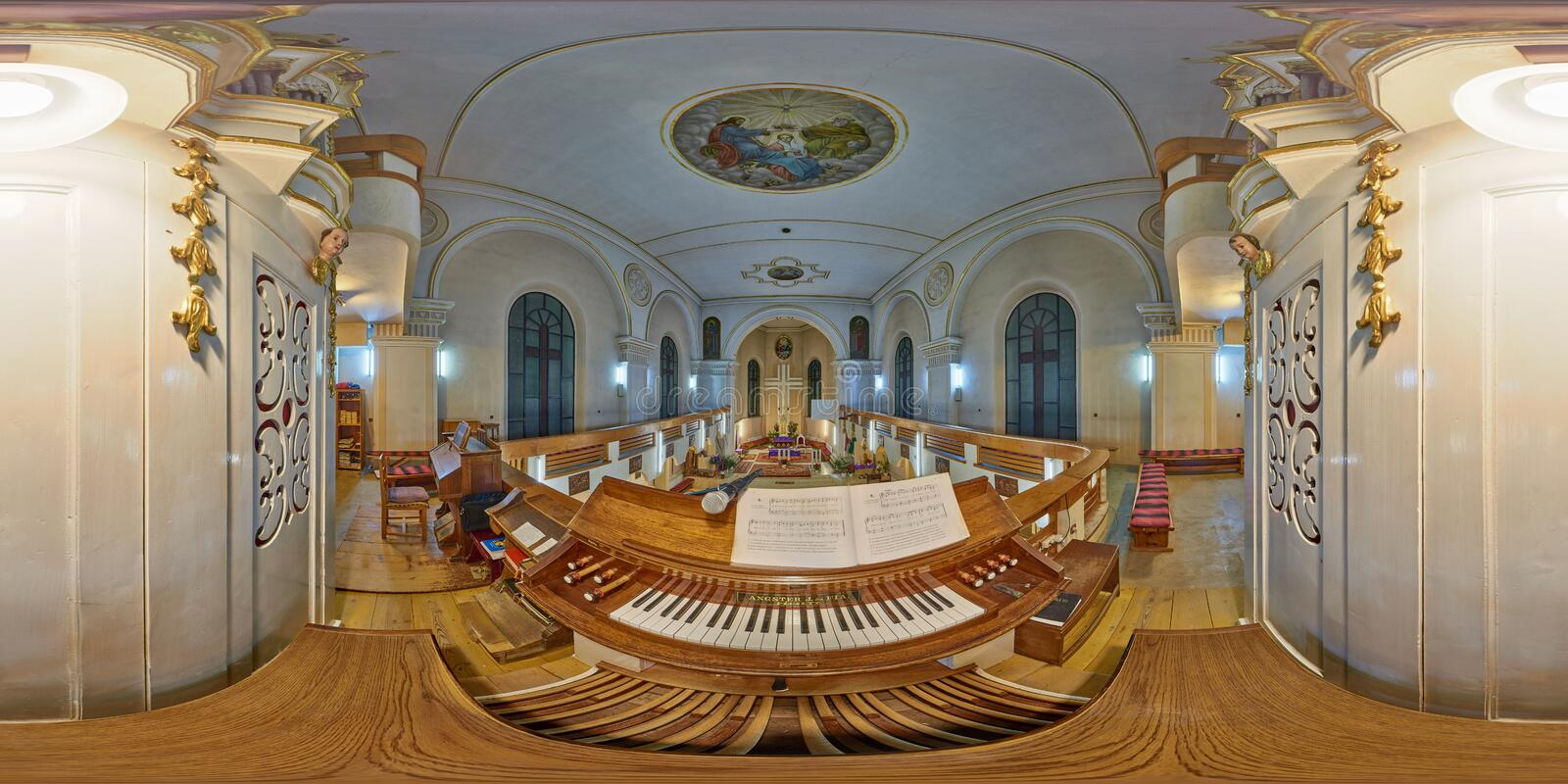 360 inteior panorama from the organist`s point of view in Holy Trinity Catholic Church in Sovata, Romania. Interior spherical panorama shot from organist`s point royalty free stock image