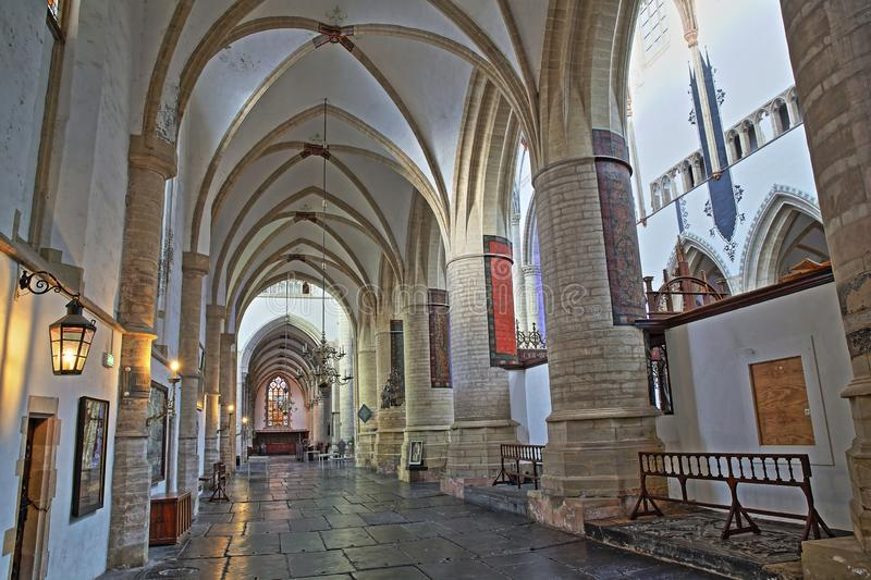 The interior of St Bavokerk Church, with  an alignement of columns and arches royalty free stock images