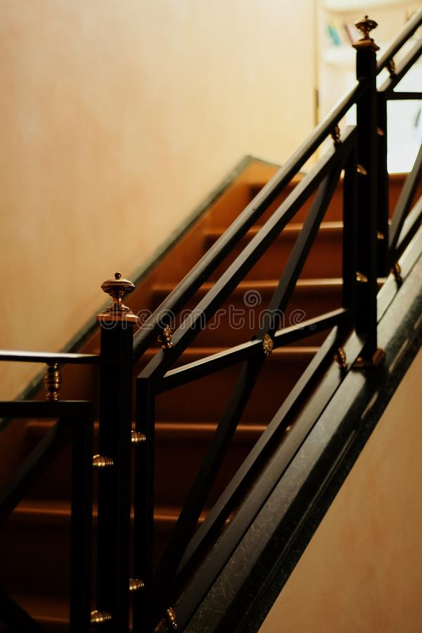 Interior Stairs stairs at home. railings vintage style white walls royalty free stock photos