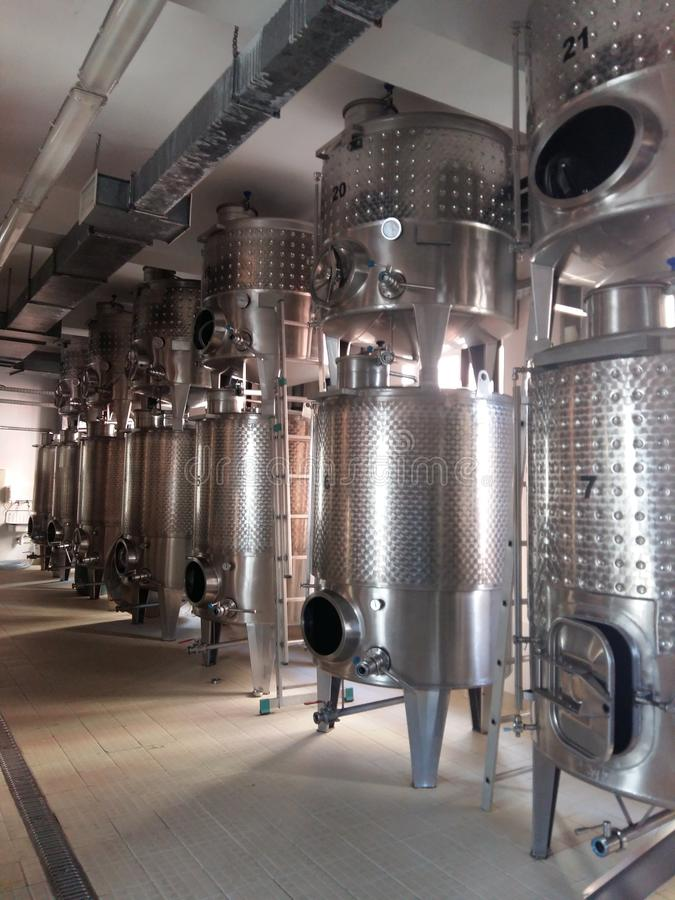 Interior of steel industrial machinery at wine manufacturing royalty free stock photo