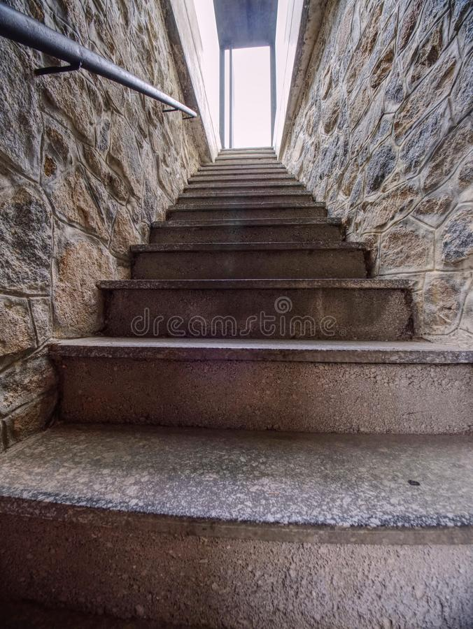 Interior of steep staircase leading to castle underground royalty free stock photography