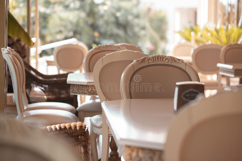 Interior of a street restaurant. A street restaurant with empty tables and chairs royalty free stock photo