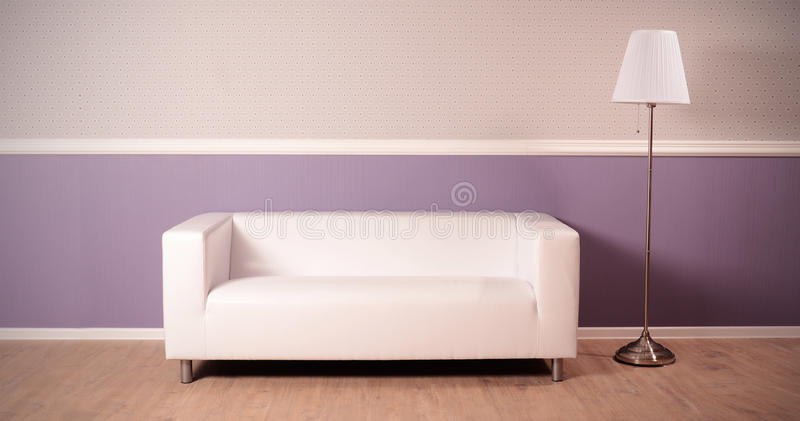 Download Interior Of Studio With Sofa And Floor Lamp Stock Photo - Image: 31637626