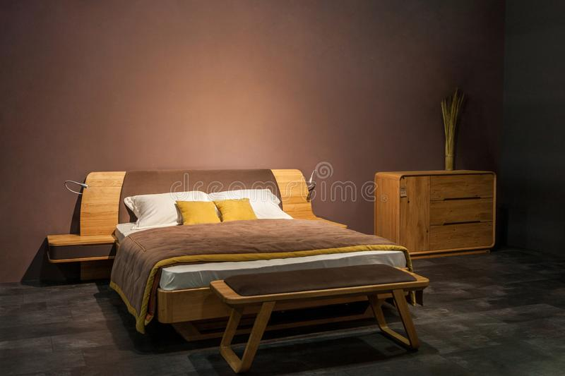 Interior of stylish bedroom in brown colors.  royalty free stock images