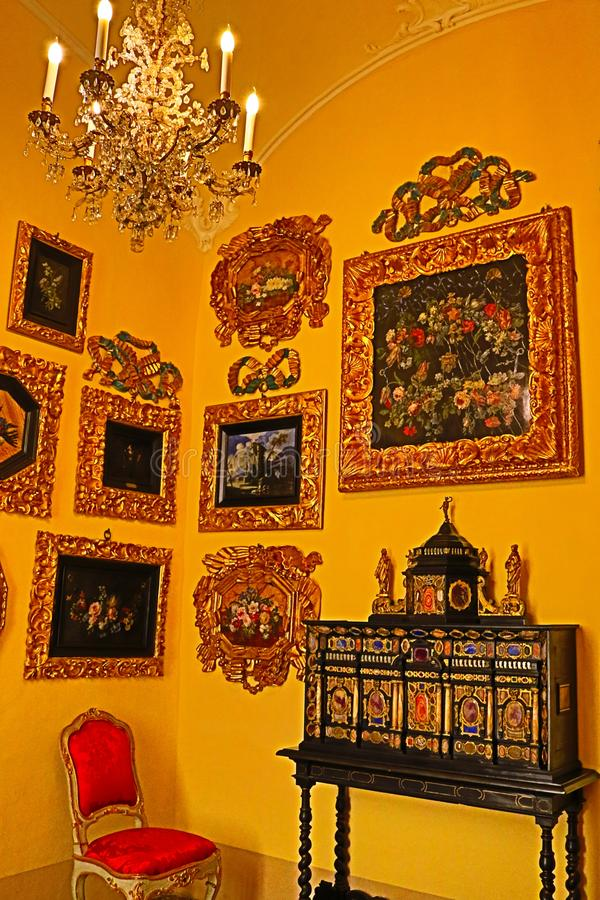 Opulent Borromeo Palace`s decoration Isola Bella Italy. The interior of sumptuous luxuriant Baroque palace with richly furnished rooms and opulent salons stock photography