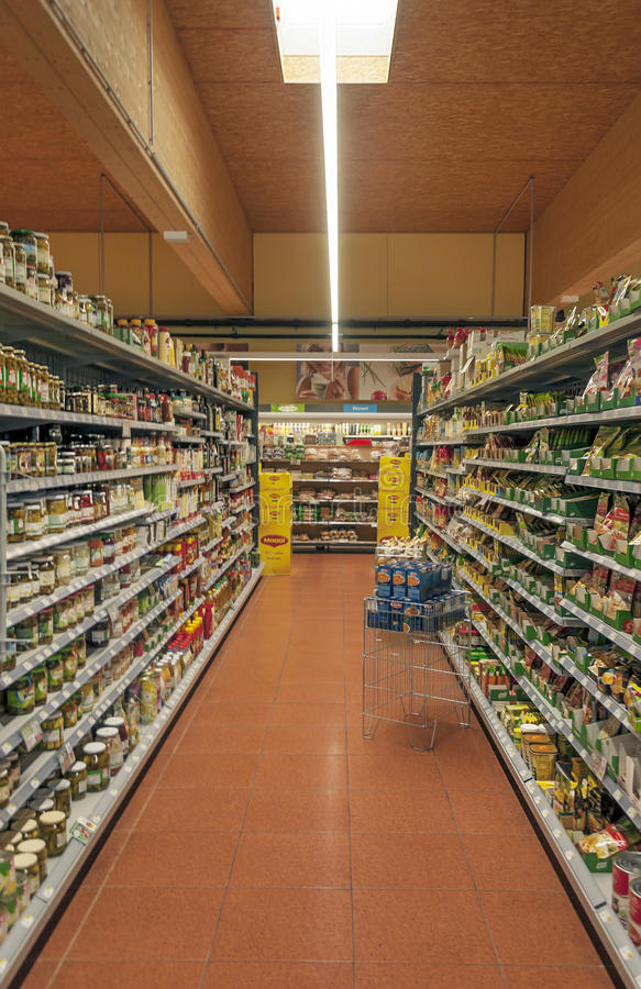 Interior of a supermarket with foodstuffs royalty free stock photo