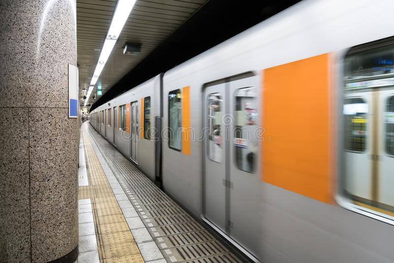 Interior of a Tokyo subway station and platform with subway comm stock photo