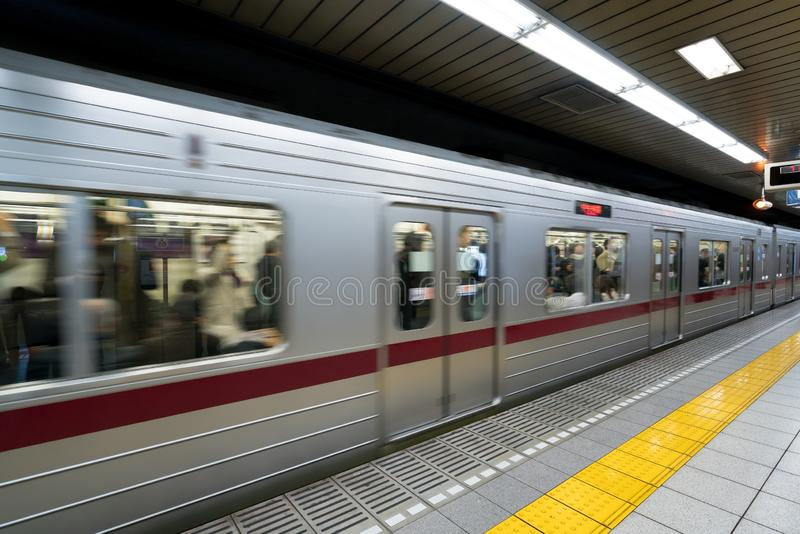 Interior of a Tokyo subway station and platform with subway commuters in Tokyo, Japan royalty free stock photos