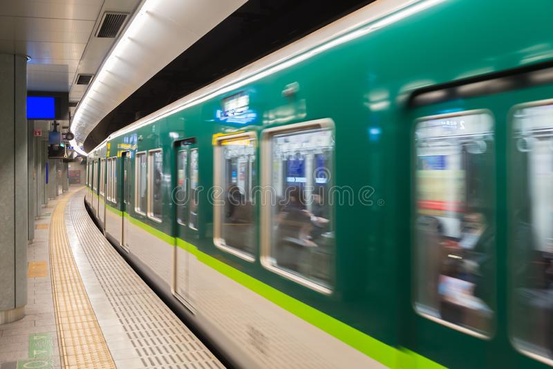Interior of a Tokyo subway station and platform with subway commuters in Tokyo, Japan royalty free stock photography