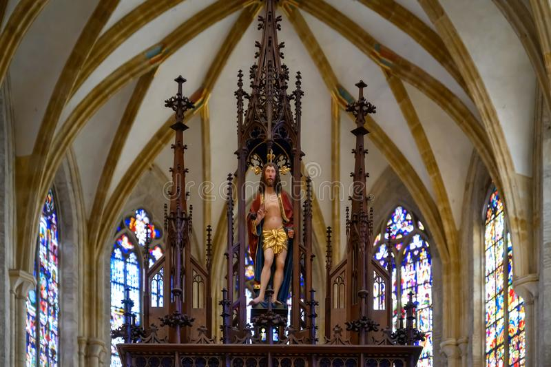 Interior Ulm Minster with vault and stained glass windows behind Jesus , Ulm Cathedral. Ulm, Baden-Wuerttemberg, Germany stock images