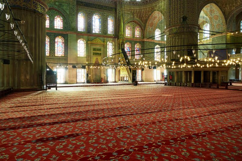 Interior view from the Blue Mosque,. Interior of the blue mosque, shining lights inside the mosque royalty free stock image
