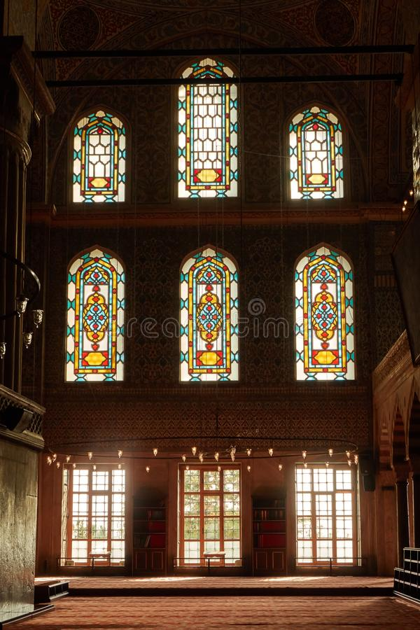 Interior view from the Blue Mosque,. Stained-glass windows with colored ornaments, columns and arches in the mosque of the city of Istanbul royalty free stock photo