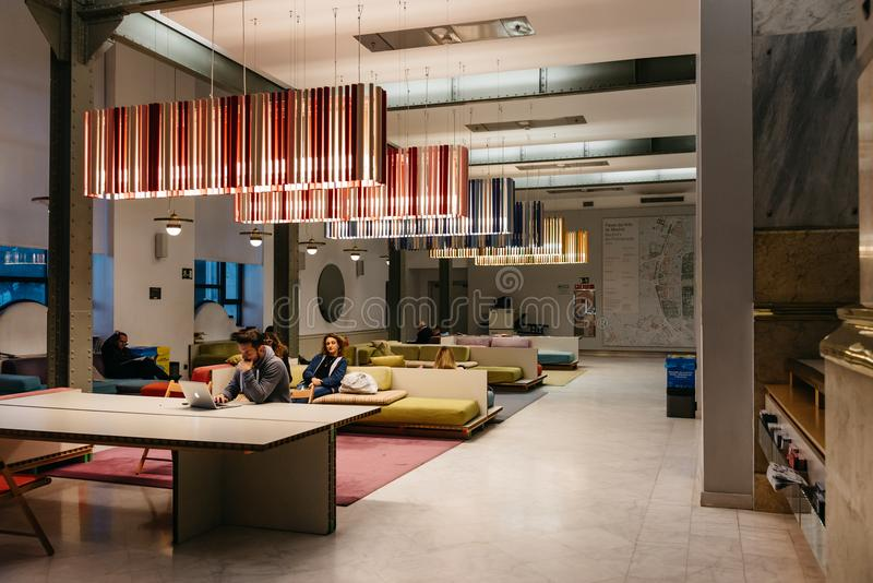 Interior view of Centro Cibeles in the new City Hall of Madrid. Madrid, Spain - November 3, 2017: Interior view of colourful lounge for reading and networking in stock photo