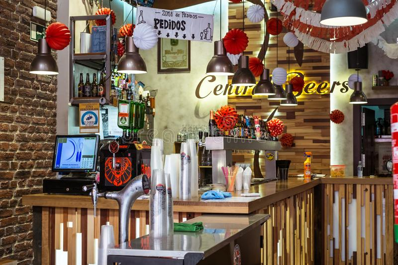Interior view of cosmopolitan and trendy bar Central beer. Malaga, Spain - August 12, 2018. Interior view of cosmopolitan and trendy bar Central beer in Old Town stock image