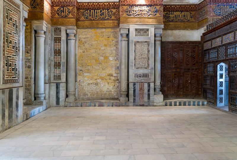 Interior view of decorated marble walls surrounding the cenotaph in the mausoleum of Sultan Qalawun, Cairo, Egypt royalty free stock image