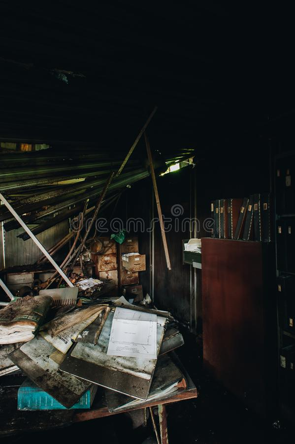 Derelict Office with Paperwork - Abandoned Fort Pitt Casting Factory - McKeesport, Pennsylvania. An interior view of a derelict office with paperwork scattered stock image