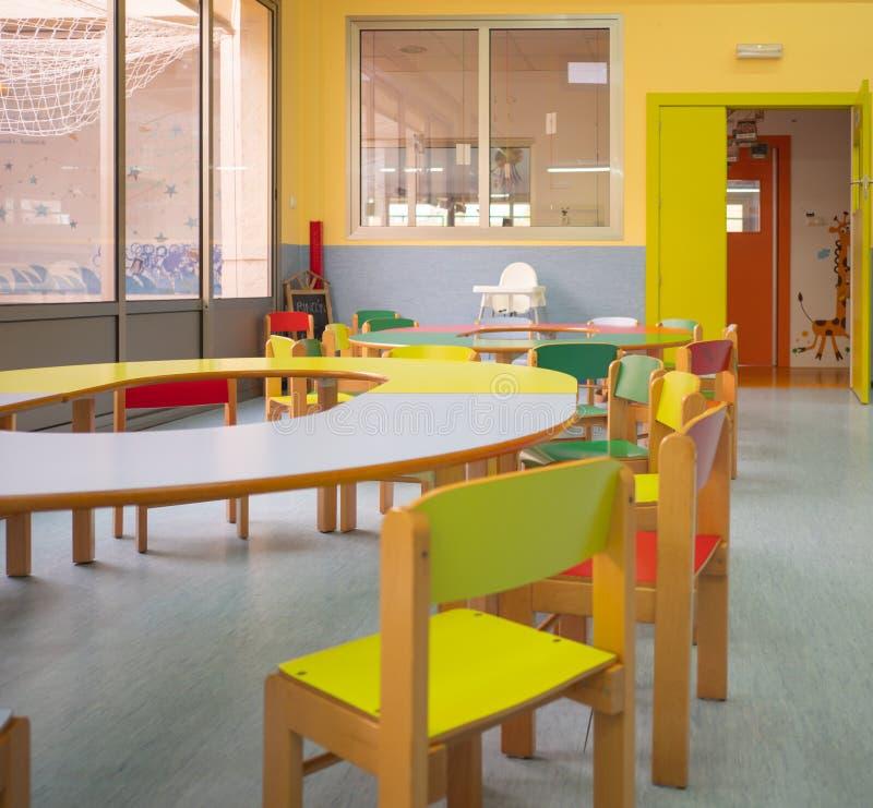 Kindergarten concept. Interior view of babys diner. Interior view of diner with colorful tables and chairs in kindergarten. Kindergarten concept stock photos