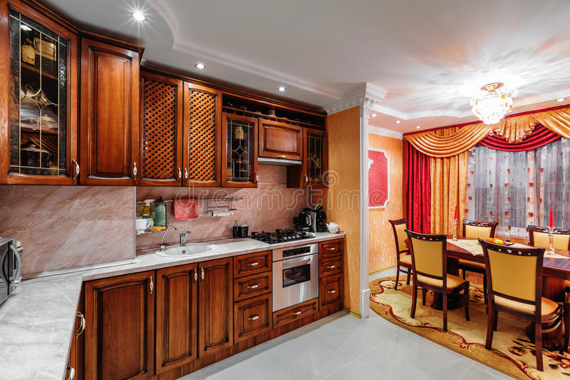 Interior view of elegant custom-built kitchen. With wooden cabinetry stock photo