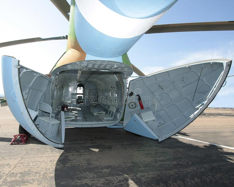 Cargo helicopter fuselage. Interior view of an empty cargo helicopter fuselage royalty free stock image