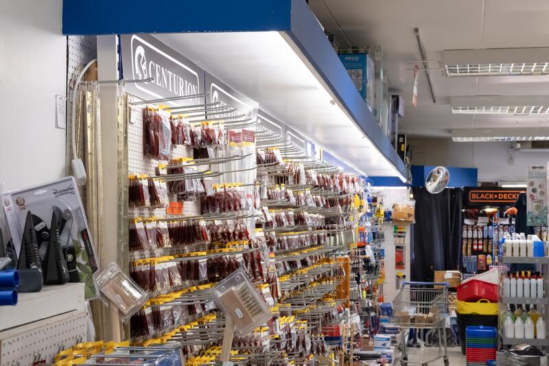 Interior view of a general hardware and DIY store showing the various hardware items and tools on display. stock images