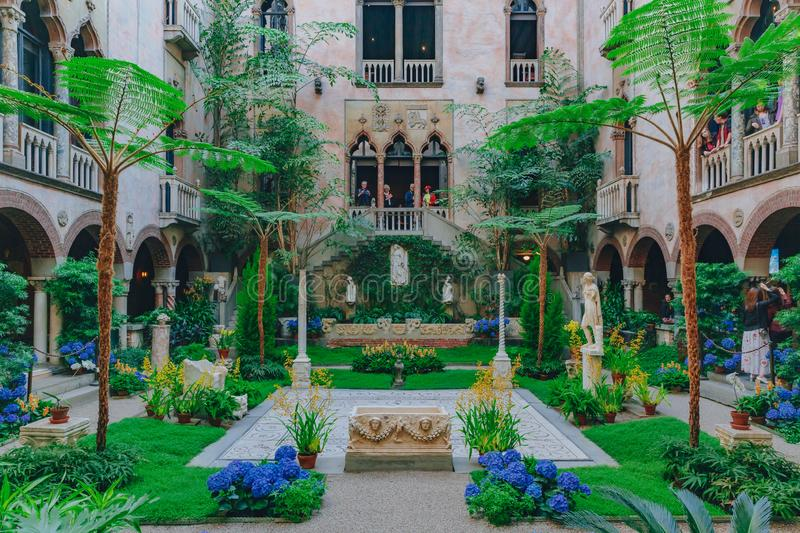Interior view of the inner courtyard and garden of Isabella Stewart Gardner Museum in Boston. Boston, USA: May 27, 2017: Interior view of the inner courtyard and royalty free stock photo