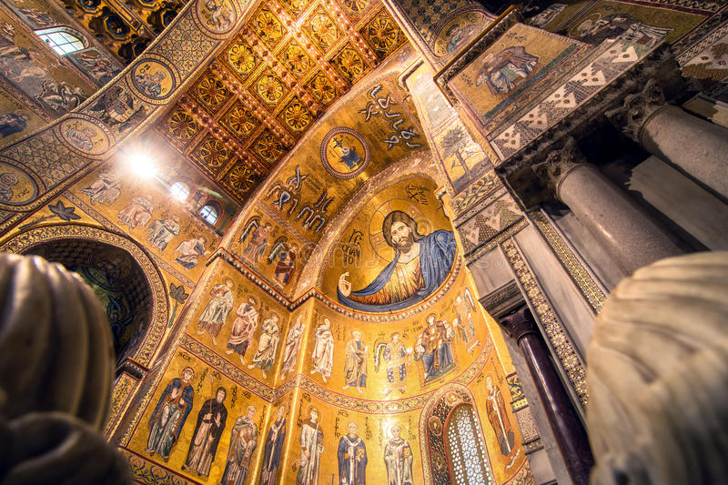 Interior view of Monreale Cathedral. MONREALE, ITALY - FEBRUARY 24, 2014: interior view of famous Santa Maria Nuova cathedral in Monreale, Italy. The Cathedral royalty free stock photo