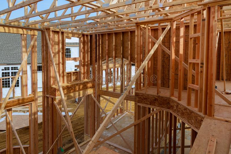 An interior view of a new home under construction with exposed wiring and and a ladder on the floor. stock photography
